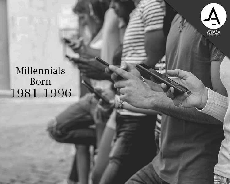 Millennial's standing against a wall on their mobile devices