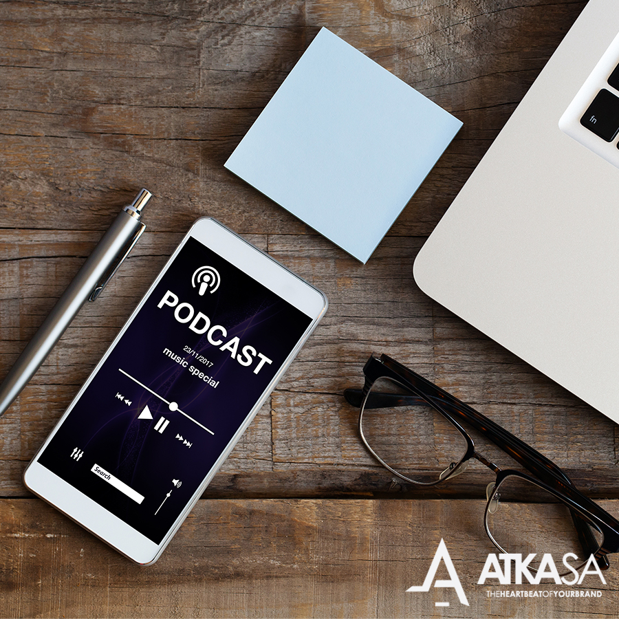 Dashboard with mobile device listining to podcast