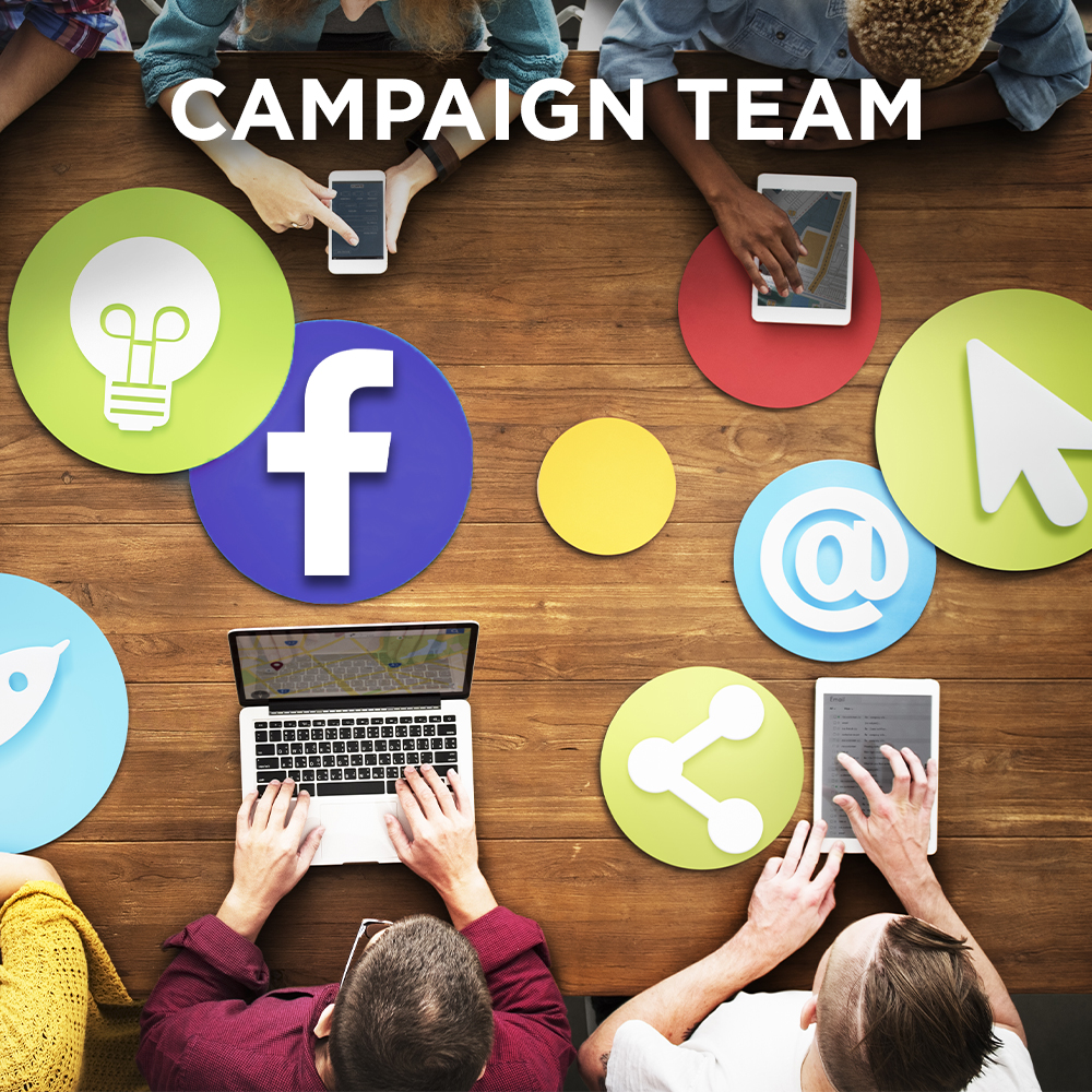 Marketing team planning a social media campaign cross platform and for multiple device types